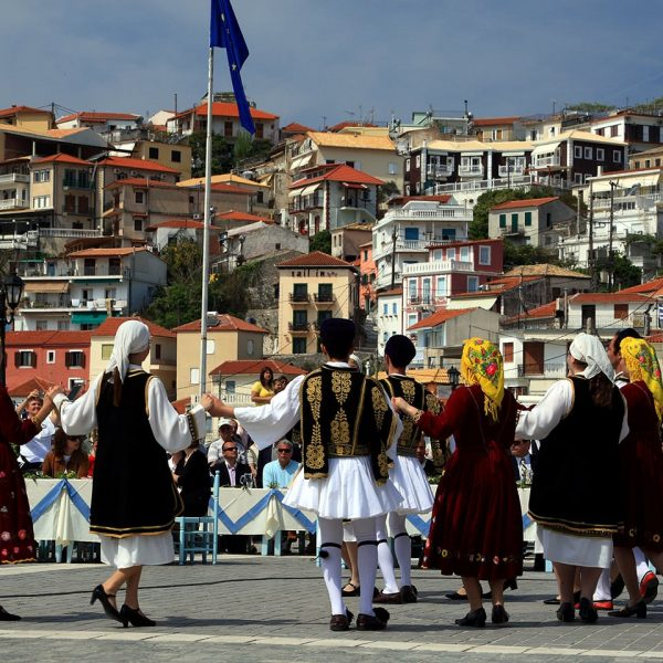 Men and women in traditional costume dancing during a traditional fest in Parga.