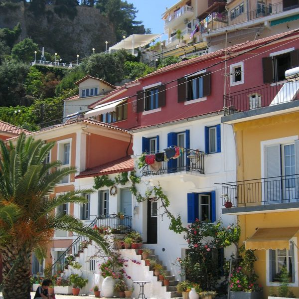 Traditional houses with colourful walls, balconies and steps in Parga.