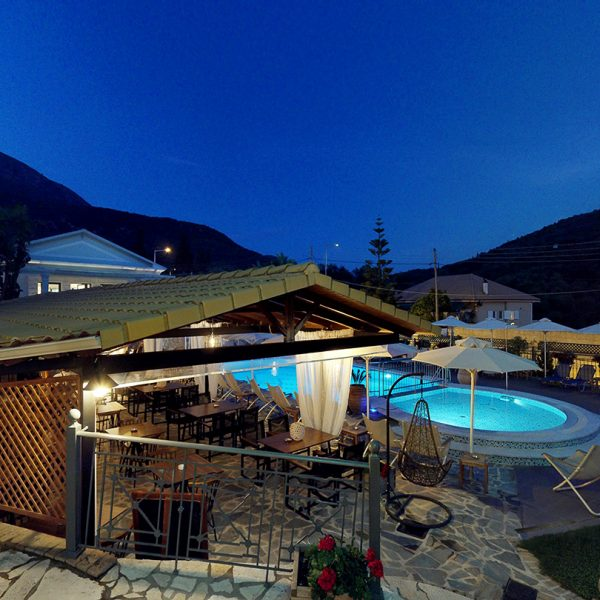 Panoramic view of the exterior and the pool area in Adams Hotel in Parga.